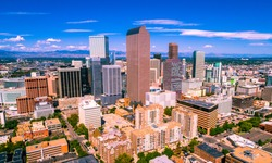 colorful Colorado above Denver , Colorado , USA skyline cityscape capital cities downtown towers rising up with the Rocky Mountain background summer sunshine