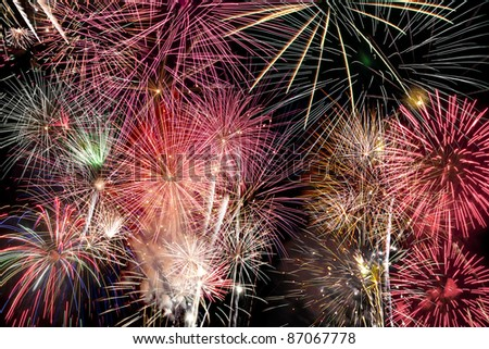 Colorful composition of fireworks over a night sky