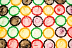 Colorful condoms background. Top view.
