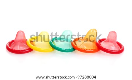 Colorful condoms isolated on white