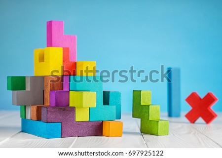 Colorful constructor, logic game, cubic mosaic. Design created by cubes. The concept of logical thinking, geometric shapes. #697925122