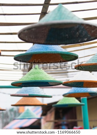 Colorful coolie straw bamboo hat in the street as decoration.