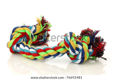 colorful cotton dog toy on a white background