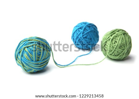 Colorful cotton thread ball from two color green and blue thread isolated on white background. Different color green and blue thread mix.  Stock foto ©