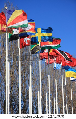 Colorful country flags isolated on a blue sky