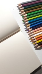 colorful crayons and a white paper