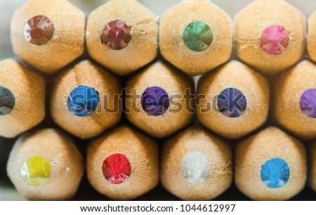colorful crayons on white background with a shallow depth of field for effect.