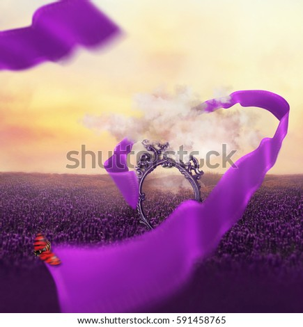 Stock Photo Colorful creative warm photo manipulation with a beautiful sunset sky, antique mirror through a clouds and flying curved ribbon with a ladybug at lavender fields.