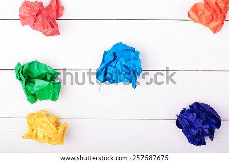 Colorful crumpled paper on a white background. Colored paper balls