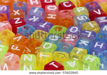 Colorful cubes with letters scattered randomly