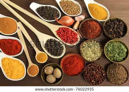Colorful cuisine ingredients - herbs and spices. Food additives.