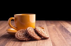 Colorful cup of coffee and cookies.