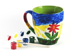 Colorful cup with watercolors and brush