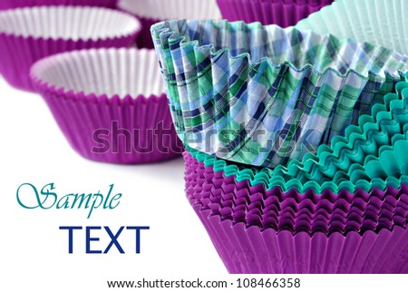 Colorful cupcake wrappers on white background with copy space.  Macro with shallow dof.