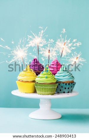 Colorful cupcakes decorated with sparklers