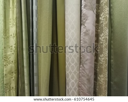 Free photos Colorful curtain samples hanging from hangers on rail in ...