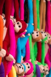 Colorful cute little monkey dolls.
