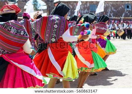 colorful dance in Peru on market on island in Lake Titicaca #560863147