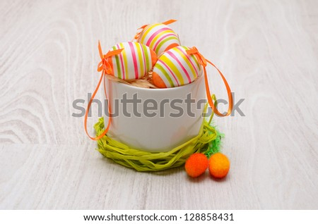 colorful decorated easter eggs on wooden background