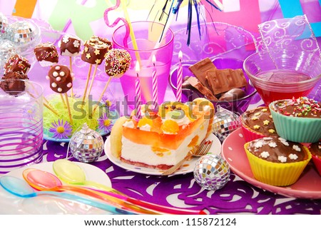 colorful decoration of birthday party table with cake and sweets for child #115872124