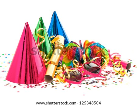 colorful decoration with garlands, streamer, cracker, party glasses and confetti. festive accessory background