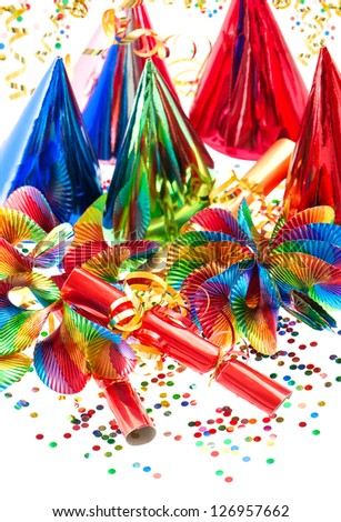 colorful decoration with garlands, streamer, party hats and confetti. festive background