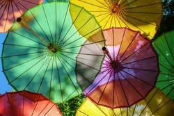 Colorful decorative umbrellas. Colorful umbrellas suspended in the air,selective focus