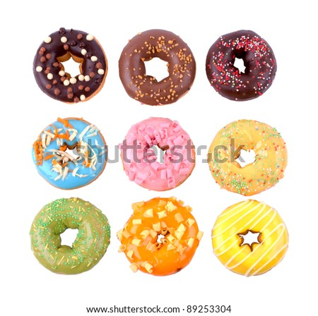 Colorful delicious donuts isolated on white background.