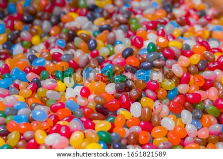 Colorful delicious glazed sugar plums background, copy space, pattern. Dessert, sweet food and confectionery concept