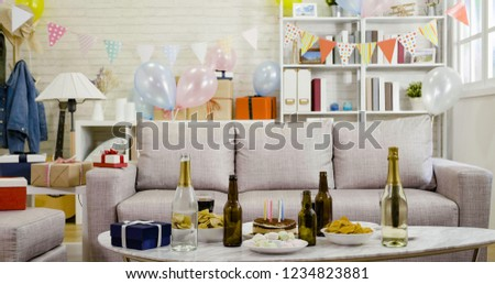 Colorful dessert table with decoration for birthday. young people celebration with alcohol house party with nobody in the room. balloons and presents at home.