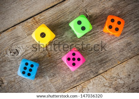 Colorful dice on the old wooden floor #147036320
