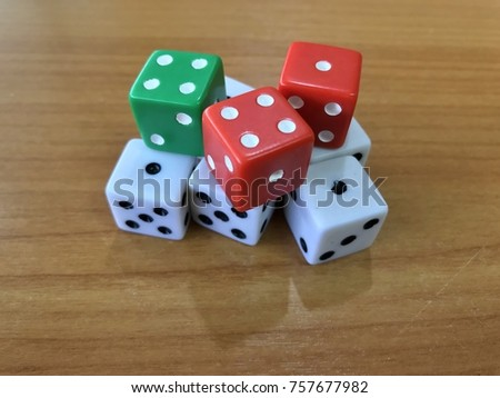 Colorful dice on wooden table for gaming #757677982