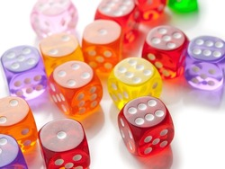 Colorful dice scattered on white surface.