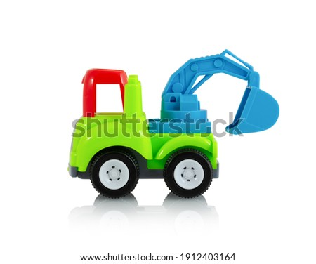 Colorful digging truck toy isolated on white background with shadow reflection, clipping, vector path. Plastic child plaything on white backdrop. Construction vehicle. Children's tractor toy. ストックフォト ©