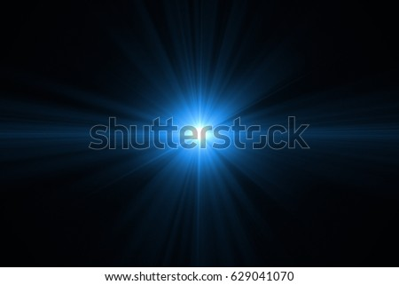 Photo of  colorful digital lens flare with bright light in black background used for texture and material