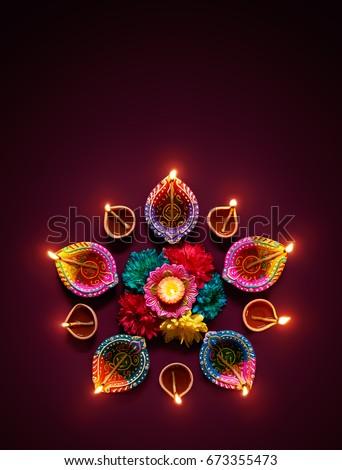 Colorful diya lamps lit during diwali celebration #673355473