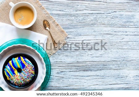 Colorful Donuts breakfast composition with different color styles of doughnuts over an aged wooden desk background. #492345346
