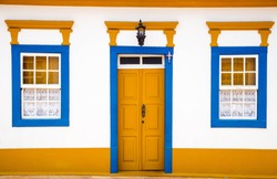 Colorful door and windows of a colonial house in the historical town of Tiradentes, Minas Gerais, Brazil