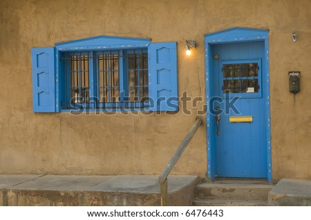 colorful doorway and window of an adobe building in Santa Fe, New Mexico