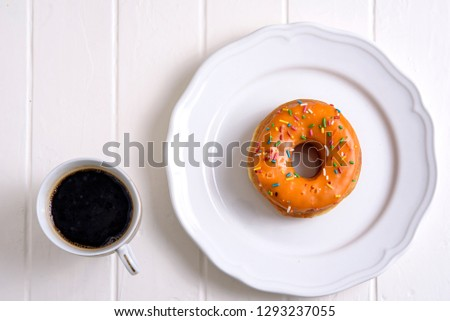 Colorful Doughnuts with coffee in white background