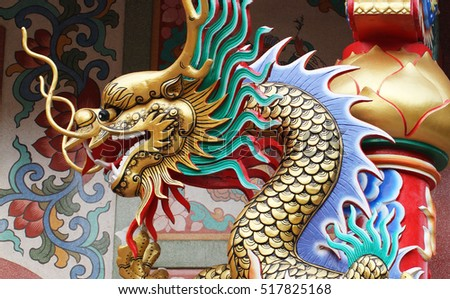 colorful dragon statue on the roof of chinese temple