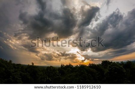 colorful dramatic sky with cloud at sunset. #1185912610