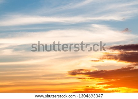 colorful dramatic sky with cloud at sunset #1304693347