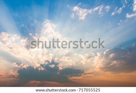 colorful dramatic sky with cloud at sunset.