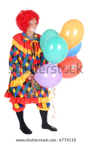 Colorful dressed female holiday clown with balloons, happy joyful expression on face