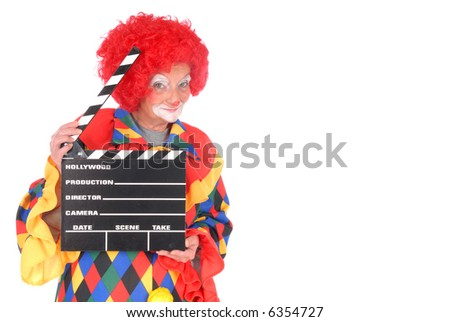 Colorful dressed female holiday clown with with movie clipboard, happy joyful expression on face, copy space