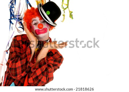 Colorful dressed male holiday clown, happy joyful expression on face. Studio shot.