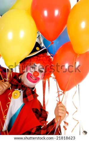 Colorful dressed male holiday clown with balloons, happy joyful expression on face. Studio shot.