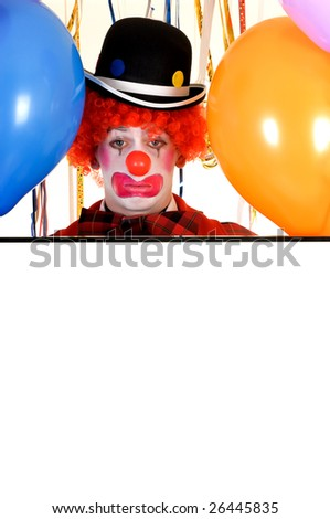 Colorful dressed male holiday clown with balloons, room for text. Studio shot.