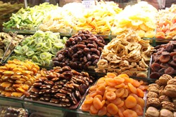 colorful dried fruits showcased as merchandise in a market stall